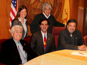 Governor Richardson Signs the Title Insurance Reform Bill. Pictured are Kristina Fisher, Regis Pecos, Speaker Ben Lujan, Fred Nathan & Governor Richardson.